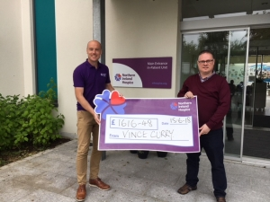 Vince presenting monies raised to Johnny from NI Hospice