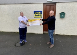 Micky handing over raised funds